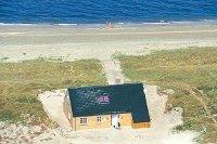 vakantiehuis op een uitgestrekt strandgrondstuk