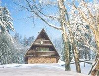 Betoverde hutten in de sneeuw