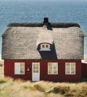 Maison au toit de chaume pour 6 personnes située sur la côte danoise de la mer du Nord.
