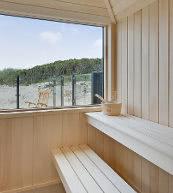 Sauna d'une maison de vacances pour dix personnes située à Holmsland Klit.